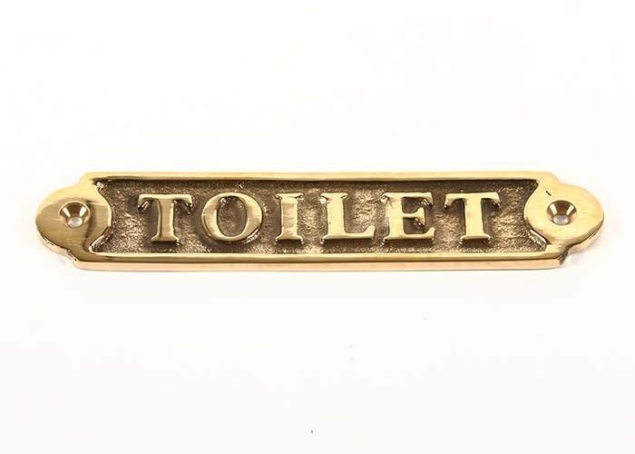 Mässingskylt Toilet